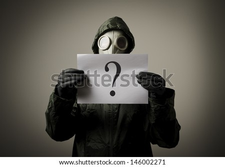 Gas mask and question. Man having no answers to a question - stock photo