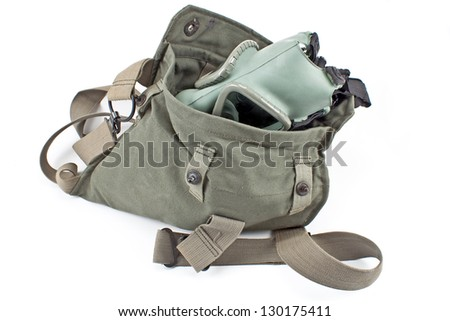 Gas mask in military canvas bag isolated on white background