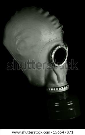 gas mask isolated on black - stock photo