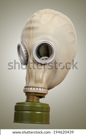 Gas mask on a gray background. - stock photo