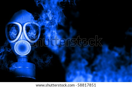 Gas mask with fiery flames - stock photo