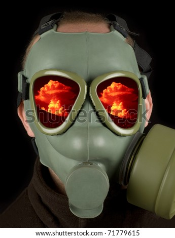 Gas mask with reflections of nuclear mushroom on eye visors - stock photo