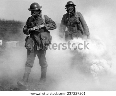 Gas masked soldier walk through an actual gas attack during training Edgewood Maryland. - stock photo