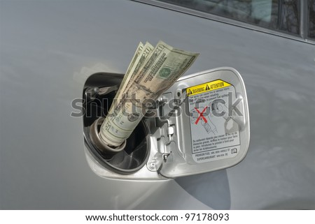 Gas money is going up every week - stock photo