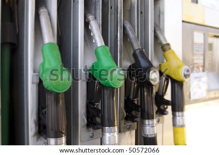 Gas nozzles at the gas station - stock photo