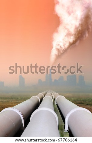 gas pipe line and atmospheric air pollution from factory - stock photo