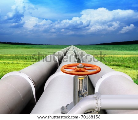 gas pipe line and valve that laid through green field - stock photo