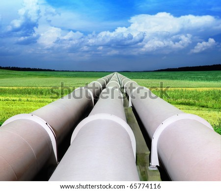 gas pipe line that laid through green field - stock photo