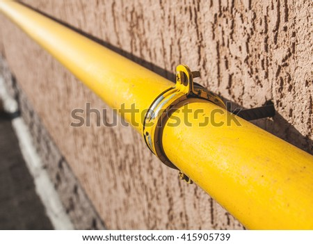 gas pipe on the wall - stock photo