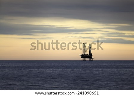 Gas platform at sunset - stock photo