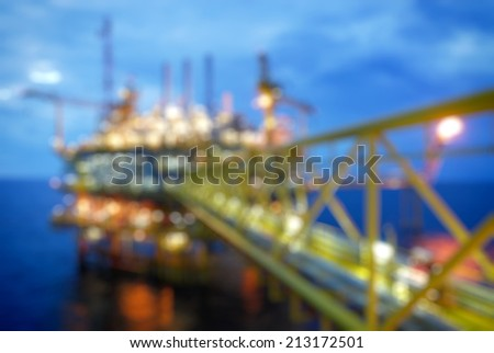 Gas platform or rig platform, blur and bokeh light - stock photo