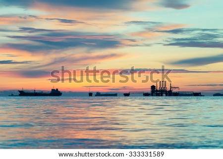 Gas platform or rig platform in sunset or sunrise time - stock photo
