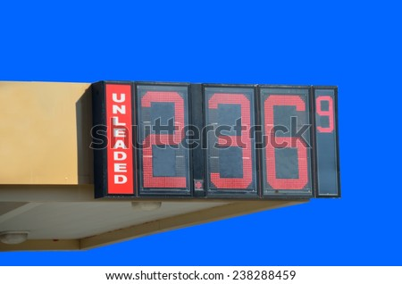 Gas price sign at pump station - stock photo