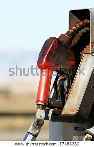 gas pump close up in rural area - dirty grungy greasy with copyspace - stock photo