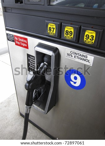 Gas pump nozzle and octane ratings - stock photo