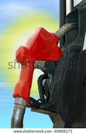 Gas pump with sun in the background - stock photo