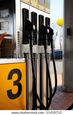 gas pumps in a petrol station - stock photo