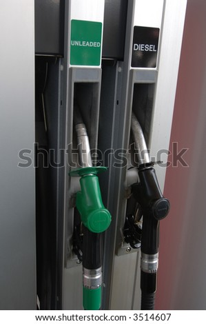 Gas Pumps showing unleaded and diesel fillers - stock photo