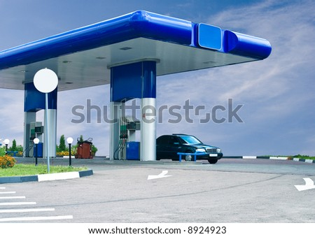 gas refuel station against cloudy sky - stock photo