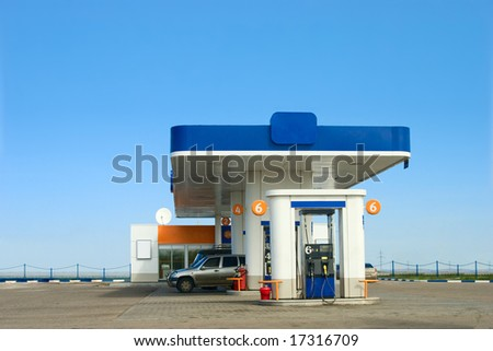 Gas refuel station and blue sky - stock photo