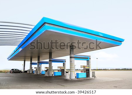Gas refuel station with blue roof close-up - stock photo