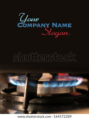 Gas ring under iron pot - stock photo