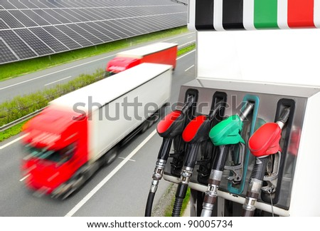 Gas station and motion blurred trucks on highway. Environmental metaphor. Picture with space for your text. - stock photo