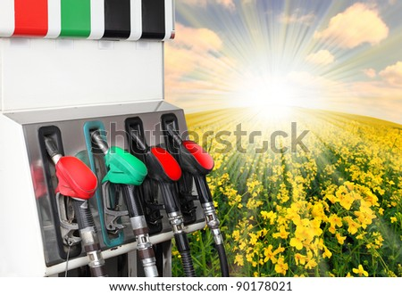 Gas station and rape field. Ecology concept. - stock photo