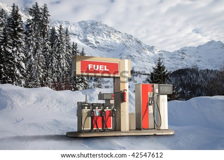 gas station in a snowy landscape - stock photo