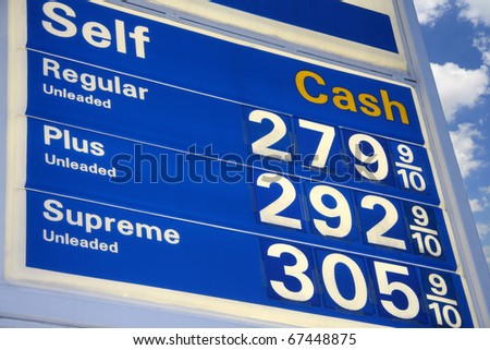 gas station sign with prices - stock photo
