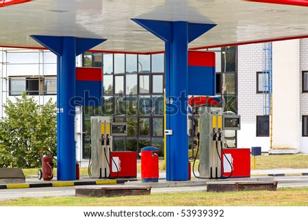 Gas station with glass building in the back - stock photo