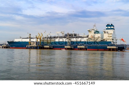 Gas storage and liquefaction ship - stock photo