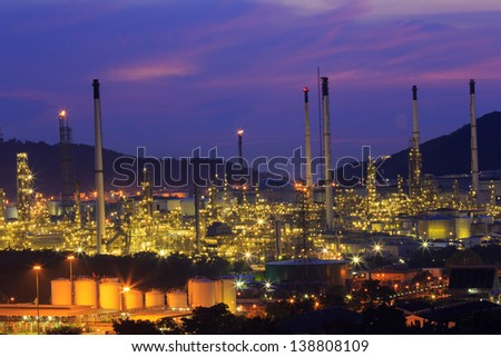 Gas storage spheres tank in petrochemical plant at night
