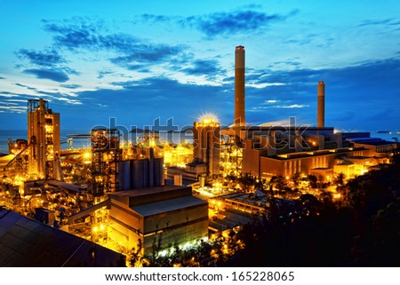 Gas storage spheres tank in petrochemical plant in sunset  - stock photo