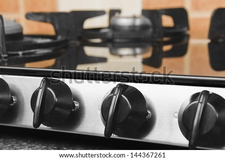 Gas stove on a kitchen counter - stock photo