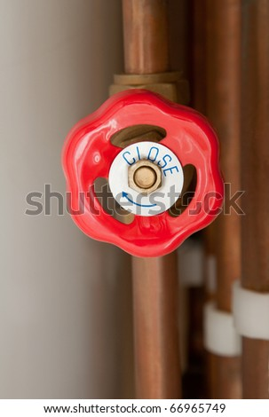 Gas tap as part of a central heating system - stock photo