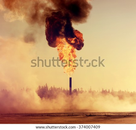 Gas Torch. Evaporation of snow around huge fire. - stock photo