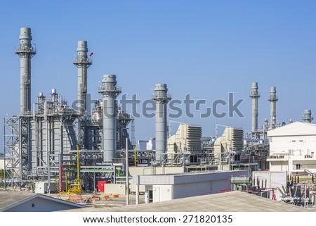Gas turbine power plant with blue sky - stock photo
