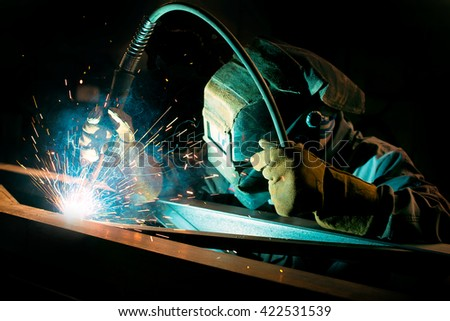 gas welding metal support for the telecommunications. welding work - stock photo