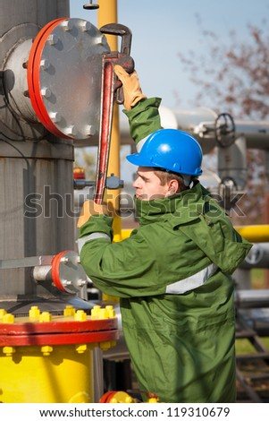 Gas worker and large gas pipelines - stock photo