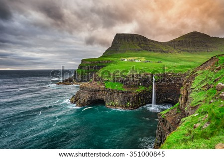 Gasadalur village and its iconic waterfall, Vagar, Faroe Islands, Denmark - stock photo