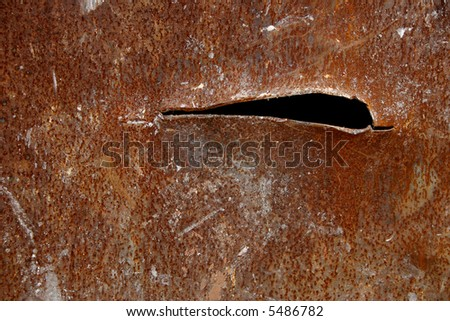 Gash in rusted metal plate - stock photo