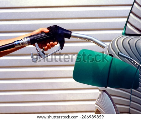 gasoline fuel in car at gas station - stock photo