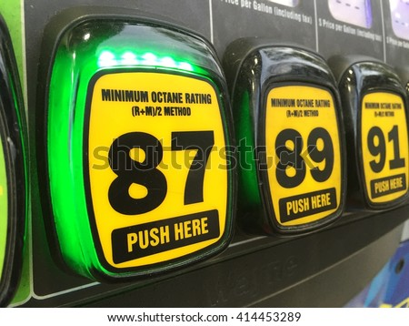 Gasoline octane selection buttons at a typical self service gas station. Regular unleaded 87 octane fuel selected. - stock photo