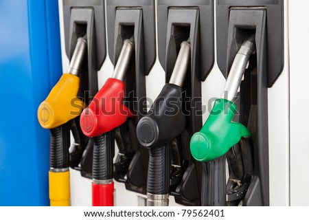 Gasoline or petrol station gas fuel pump nozzle - stock photo