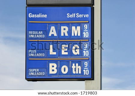 Gasoline prices : gas price sign with a humorous slant. - stock photo