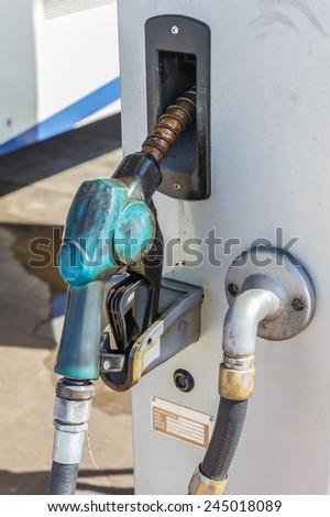gasoline pump nozzles - stock photo