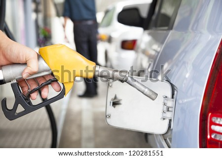 Gasoline pump refilling automobile fuel - stock photo