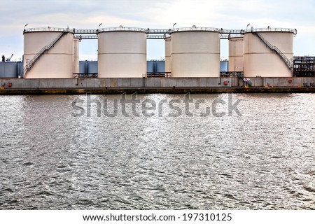 Gasoline storage tanks in the seaport. Seaport. - stock photo
