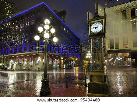 Gastown Steam Clock in Vancouver BC Canada on a Rainy Night - stock photo